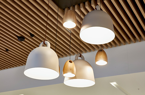 Examples of semi-exposed ceiling systems by Supawood